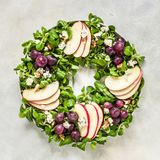 Christmas Wreath Salad. Spinach and Corn Salad, Apple, Blue Cheese, Grapes and Honey Dressing, square stock photography