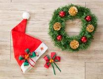 Christmas wreath,  Santa claus hat  and ribbon bow Royalty Free Stock Image