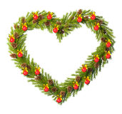 Christmas wreath in the shape of heart isolated on white Royalty Free Stock Photo