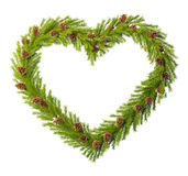 Christmas wreath in the shape of heart isolated on white Royalty Free Stock Photography