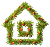 Christmas wreath in the shape of house  on white Royalty Free Stock Photos