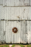 Christmas wreath on side of barn Stock Images