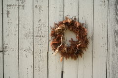 Christmas wreath on side of barn Stock Photography