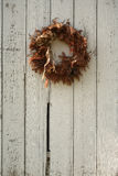 Christmas wreath on side of barn Royalty Free Stock Photo