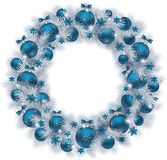Christmas wreath with silver colour fir branches and blue balls. Christmas wreath with silver colour fir branches, blue balls and decorations isolated on white Royalty Free Stock Photos