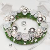 Christmas wreath with silver decorations and candles on white background stock photos