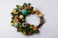 Christmas wreath with snowy pine cones and rustic ornaments royalty free stock photos