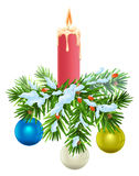 Christmas wreath. Spruce branches under snow, burning candle and balls Stock Photos