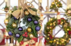 Christmas wreath of spruce, purple and gold balls royalty free stock image