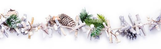 Christmas wreath in studio with copy space. Cones and wood xmas decoration on white background stock photo