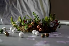 Christmas wreath with succulent plants, decorative balls and bells. Christmas wreath with succulent plants, decorative pearl balls and bell shaped forms royalty free stock photo