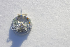 Christmas wreath in the sunlight in the fresh snow Stock Photos