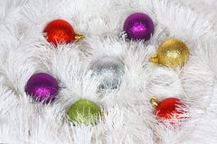 Christmas wreath of tinsel and colored balls Stock Photo