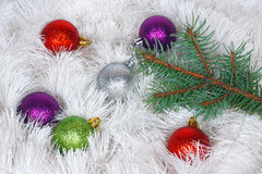 Christmas wreath of tinsel and colored balls Stock Image