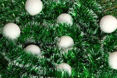 Christmas wreath of tinsel and white balls Stock Photography