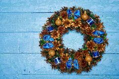 Christmas wreath top view. Christmas wreath on blue painted wooden background royalty free stock photo