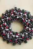 Christmas wreath made of branches, cones, red berries royalty free stock photos