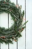 Christmas wreath of tree branches on wooden background stock image