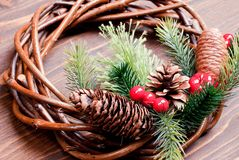 Christmas wreath of twigs with pine needles and cones on a brown Stock Image