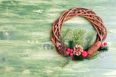 Christmas wreath of twigs with pine needles and cones on a green Stock Photography