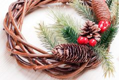 Christmas wreath of twigs with pine needles and cones on light b Stock Images