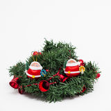 Christmas wreath with two small red Santa Claus Stock Image