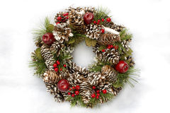 Christmas Wreath on White Background. Christmas wreath against a white background with pine cones, berries and foliage Stock Photo