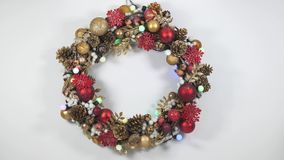 Christmas wreath on a white background. With flashing garland stock video footage