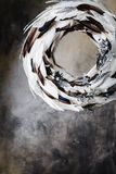 Christmas wreath of feathers on a gray background with divorces Stock Images