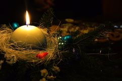 Christmas wreath with white candle Stock Image