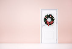 Christmas Wreath on White Door Royalty Free Stock Photos
