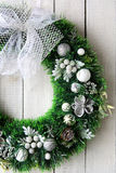 Christmas wreath on white door Royalty Free Stock Images