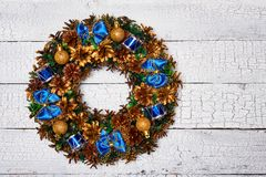 Christmas wreath top view. Christmas wreath on white painted wooden background stock photo