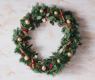 Christmas wreath on a white vintage background Stock Photos