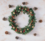 Christmas wreath on a white vintage background. Christmas wreath with pine and berries on a white vintage background stock photography