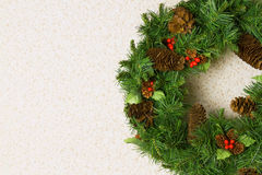 Christmas wreath on a white wall Royalty Free Stock Image