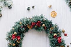 Christmas wreath on a white wooden background.  royalty free stock photography