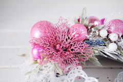 Christmas wreath winter holiday door decoration in white and pin Royalty Free Stock Image