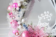 Christmas wreath winter holiday door decoration in white and pin Stock Photo