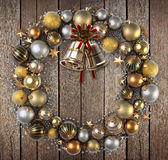 Christmas wreath and wood background Stock Photos