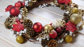 Christmas wreath on a wood background. Rotating detail of a christmas wreath on a wood background stock footage