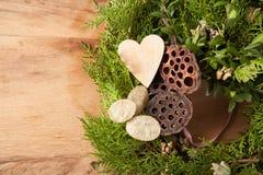 Christmas wreath on wood desk. Happy new year background stock photo