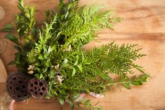 Christmas wreath on wood desk. Happy new year background royalty free stock images