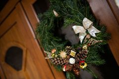 Christmas wreath on wood front door royalty free stock image