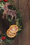 Christmas wreath on the wood. Texture Stock Photos