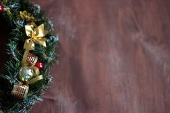 Christmas wreath in the wooden background royalty free stock photography