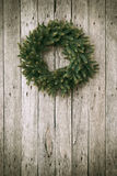 Christmas Wreath on Wooden Background Royalty Free Stock Photo
