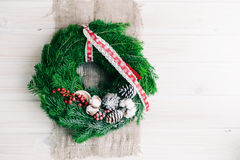 Christmas wreath. On a wooden background Royalty Free Stock Images