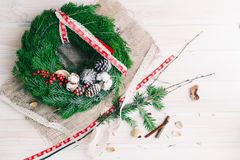 Christmas wreath. On a wooden background Royalty Free Stock Photo