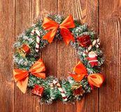 Christmas wreath on wooden background as Christmas decoration.  stock images